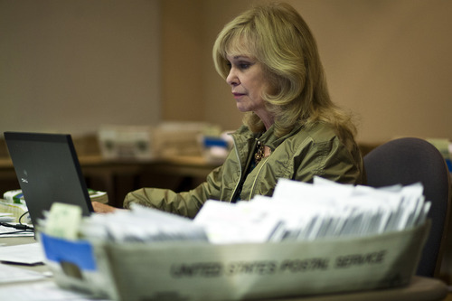 Chris Detrick  |  The Salt Lake Tribune Salt Lake County Clerk Sherrie Swensen verifies some of the thousands of provisional and absentee ballots still being counted to meet the deadline for an official election total on Tuesday.