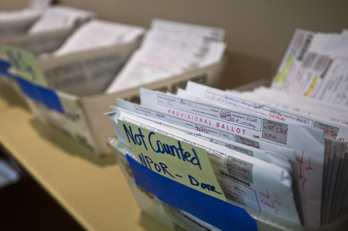 Chris Detrick  |  The Salt Lake Tribune Trays of provisional ballots wait to be verified at the Salt Lake County Clerks Office on Friday. Election staff try to count every vote, but some must be set aside because of incomplete information or mistakes.