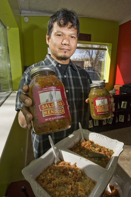 Paul Fraughton | The Salt Lake Tribune. Sergio Mendoza holds bottles of gourmet salsas he makes and sells at Salsa Mendoza. Small business advocates are urging Utahns to shop locally this holiday season at businesses like Mendoza's.