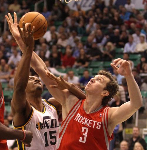 Rick Egan  | The Salt Lake Tribune   Utah Jazz power forward Derrick Favors (15) shoots over Houston Rockets center Omer Asik (3) in NBA action, Jazz vs. the Houston Rocket's. Monday, November 19, 2012.