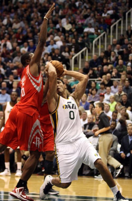 Rick Egan  | The Salt Lake Tribune   Houston Rockets power forward Terrence Jones (6) defends as Utah Jazz center Enes Kanter (0) looks for a shot, in NBA action, Jazz vs. the Houston Rocket's. Monday, November 19, 2012.
