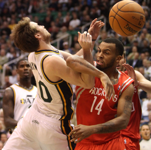 Rick Egan  | The Salt Lake Tribune   Utah Jazz shooting guard Gordon Hayward (20) is fouled by Houston Rockets shooting guard Daequan Cook (14), in NBA action, Jazz vs. the Houston Rocket's. Monday, November 19, 2012.