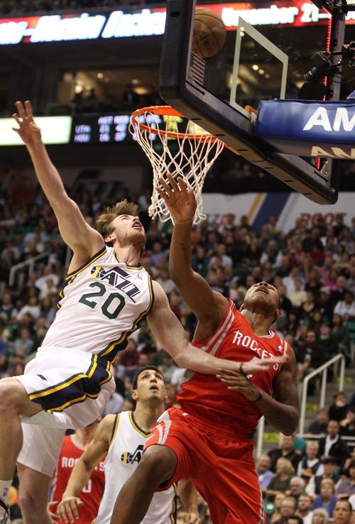 Rick Egan  | The Salt Lake Tribune   Utah Jazz shooting guard Gordon Hayward (20) is fouled by Houston Rockets power forward Greg Smith (4), in NBA action, Jazz vs. the Houston Rocket's. Monday, November 19, 2012.