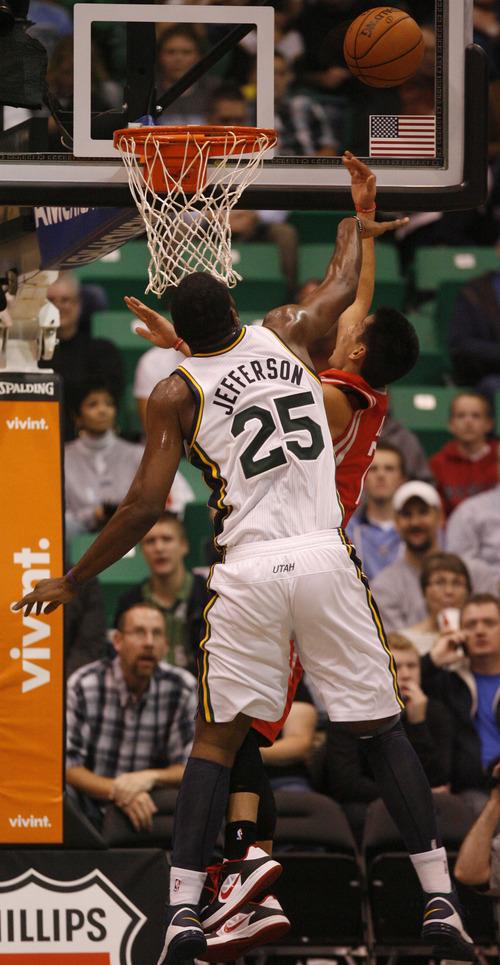 Rick Egan  | The Salt Lake Tribune   Utah Jazz center Al Jefferson (25) blocks a shot by Houston Rockets point guard Jeremy Lin (7), in NBA action, Jazz vs. the Houston Rocket's. Monday, November 19, 2012.