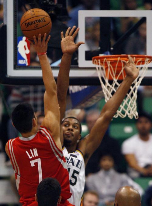 Rick Egan  | The Salt Lake Tribune   Utah Jazz power forward Derrick Favors (15) defends Houston Rockets point guard Jeremy Lin (7), goes up for a shot, in NBA action, Jazz vs. the Houston Rocket's. Monday, November 19, 2012.