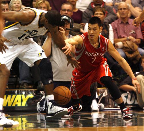 Rick Egan  | The Salt Lake Tribune    Utah Jazz power forward Derrick Favors (15) steals the ball from Houston Rockets point guard Jeremy Lin (7), in NBA action, Jazz vs. the Houston Rocket's. Monday, November 19, 2012.