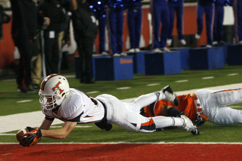 Chris Detrick  |  The Salt Lake Tribune Timpview's Britain Covey (84) scores a touchdown past Mountain Crest's Zach Kimball (11) during the second half of the 4A championship game at Rice-Eccles Stadium Friday November 16, 2012. Timpview defeated Mountain Crest 38-31
