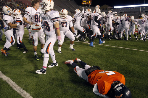 Chris Detrick  |  The Salt Lake Tribune Mountain Crest's Jamison Webb (5) remains on the field as Timpview celebrates after the 4A championship game at Rice-Eccles Stadium Friday November 16, 2012. Timpview defeated Mountain Crest 38-31