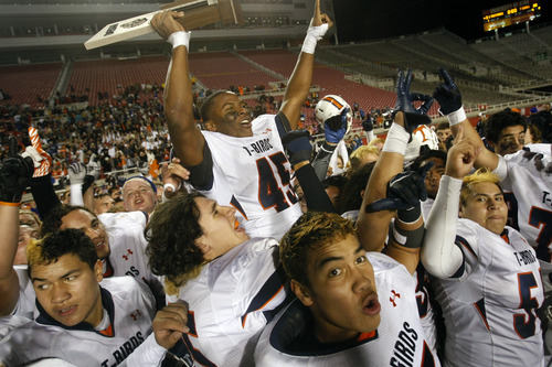 Chris Detrick  |  The Salt Lake Tribune Timpview players carry Pita Taumoepenu on their shoulders after he registered the game-ending sack that gave the T-birds the state title.