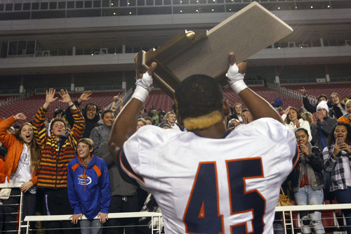 Chris Detrick  |  The Salt Lake Tribune Timpview's Pita Taumoepenu (45) celebrates with the fans after the 4A championship game at Rice-Eccles Stadium Friday November 16, 2012. Timpview defeated Mountain Crest 38-31