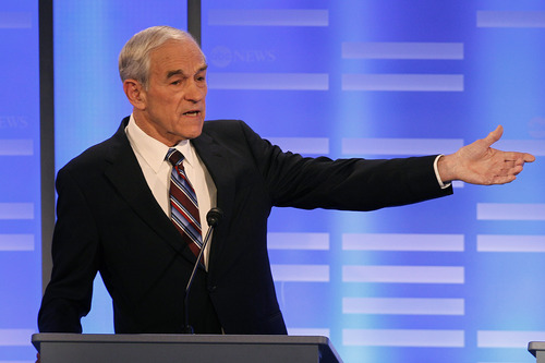 Elise Amendola  |  The Associated Press Rep. Ron Paul, R-Texas, answers a question during a Republican presidential candidate debate at Saint Anselm College in Manchester, N.H., Saturday.