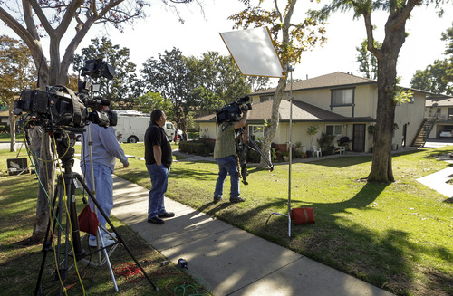 Members of the media gather outside the home of 21-year-old Miguel Alejandro Santana Vidriales of Upland, Calif. Tuesday, Nov. 20, 2012. Vidriales is one of four Southern California men charged with plotting to kill Americans and destroy U.S. targets overseas by joining al-Qaida and the Taliban in Afghanistan, federal officials said. In one online conversation, Santana told an FBI undercover agent that he wanted to commit jihad and expressed interest in a jihadist training camp in Jalalabad, Afghanistan. (AP Photo/Damian Dovarganes)