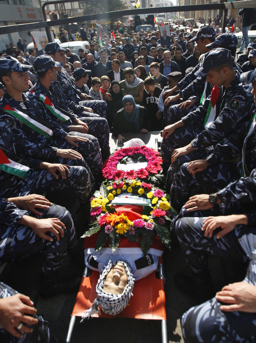 Palestinian police officers attend the funeral of Rushdi Tamimi who died of injuries sustained during clashes Saturday with Israeli security forces during a protest against Israel's operation in Gaza, in the West Bank city of Ramallah, Tuesday, Nov 20, 2012.  Efforts to end a week-old convulsion of Israeli-Palestinian violence drew in the world's top diplomats on Tuesday, with President Barack Obama dispatching his secretary of state to the region on an emergency mission and the U.N. chief appealing from Cairo for an immediate cease-fire. (AP Photo/Majdi Mohammed)