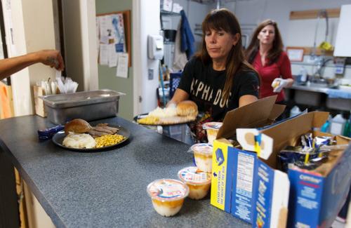 Trent Nelson     The Salt Lake Tribune Volunteers Marsha Mason and Keara Sardo serve dinner at the VOA's Youth Drop-In Center on Thursday, Nov. 15, 2012 in Salt Lake City.