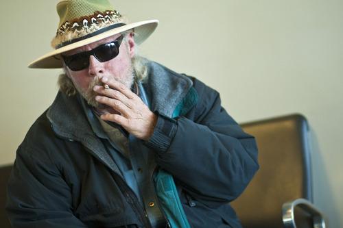 Chris Detrick  |  The Salt Lake Tribune Mark Wood, of Idaho Falls, smokes in a smoking lounge before his flight to Houston at the Salt Lake City International Airport Tuesday.