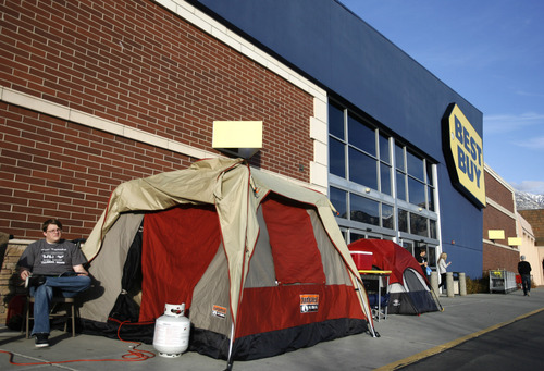 Rick Egan  | The Salt Lake Tribune   Logan Burr, Orem sits by his tent in front of the Best Buy in Orem, Monday, November 19, 2012. Burr has been in line since Monday, November 12, waiting for the big Black Friday sale at midnight on Thursday.