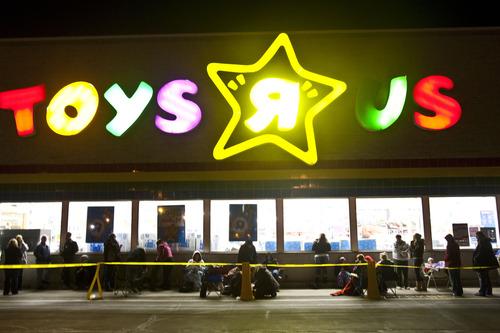 Chris Detrick  |  The Salt Lake Tribune Shoppers wait to enter Toys 'R' Us in Murray on Thursday, Nov. 24, 2011.