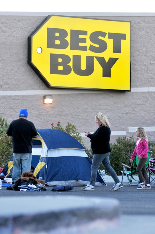 A family makes camp in a parking lot next to Best Buy in Victorville, Calif., as they wait for Black Friday on Monday, Nov. 19, 2012. (AP Photo/The Victor Valley Daily Press, David Pardo)