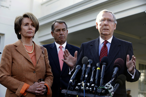 file  |  The Associated Press Tax experts says that Democratic and Republican leaders such as Senate Minority Leader Mitch McConnell, right, House Minority Leader Nancy Pelosi, left, and House Speaker John Boehner might be able to agree to a broad cap on all deductions for a household.