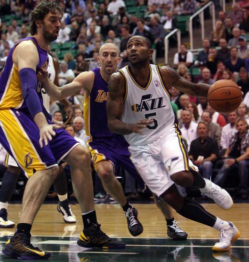 Kim Raff | The Salt Lake Tribune (right) Utah Jazz point guard Mo Williams (5) dribbles past Los Angeles Lakers power forward Pau Gasol (16) during a game at EnergySolutions Arena in Salt Lake City, Utah on November 7, 2012.