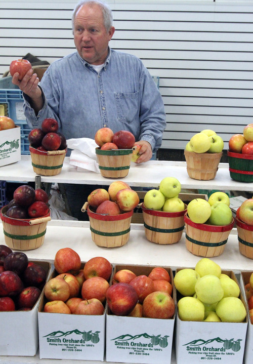Rick Egan  | The Salt Lake Tribune  Scott G. Smith, of Smith Orchards in Provo, sells apples at the winter market at the state Fairpark Saturday.