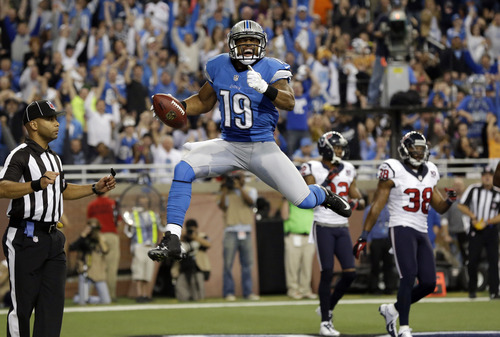 Detroit Lions receiver Mike Thomas celebrates his 5-yard touchdown reception during the second quarter of an NFL football game against the Houston Texans at Ford Field in Detroit, Thursday, Nov. 22, 2012. (AP Photo/Paul Sancya)