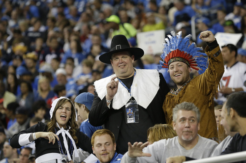 Football fans dressed as pilgrims and an Indian cheer during the second quarter of an NFL football game between the Detroit Lions and the Houston Texans at Ford Field in Detroit, Thursday, Nov. 22, 2012. (AP Photo/Paul Sancya)