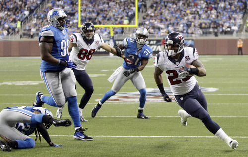 Houston Texans running back Arian Foster (23) runs into the end zone for a touchdown during the second quarter of an NFL football game against the Detroit Lions at Ford Field in Detroit, Thursday, Nov. 22, 2012. (AP Photo/Duane Burleson)