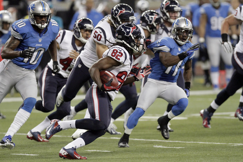 Houston Texans wide receiver Keshawn Martin (82) is chased by Detroit Lions' Kassim Osgood (10) and Stefan Logan (11) returns a kick during the first quarter of an NFL football game at Ford Field in Detroit, Thursday, Nov. 22, 2012. (AP Photo/Duane Burleson)