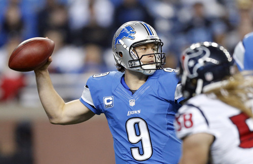Detroit Lions quarterback Matthew Stafford (9) reaches back to pass during the first quarter of an NFL football game against the Houston Texans at Ford Field in Detroit, Thursday, Nov. 22, 2012. (AP Photo/Rick Osentoski)