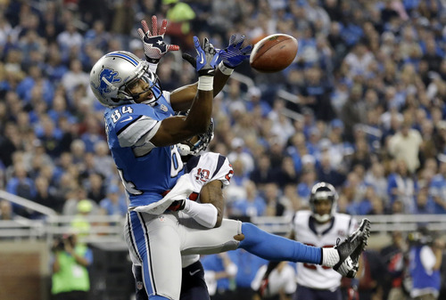 Houston Texans defensive back Brice McCain, back, knocks a pass out of the hands of Detroit Lions wide receiver Ryan Broyles (84) during the first quarter of an NFL football game at Ford Field in Detroit, Thursday, Nov. 22, 2012. (AP Photo/Paul Sancya)