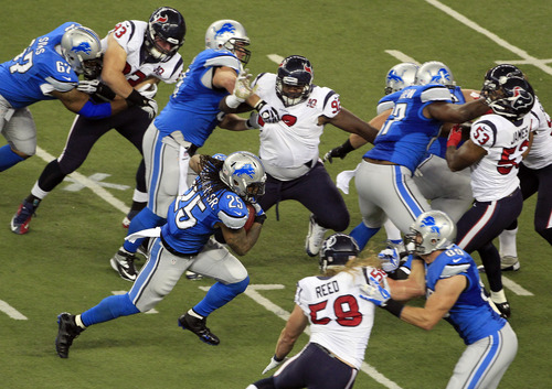 Detroit Lions running back Mikel Leshoure (25) runs during the first quarter of an NFL football game against the Houston Texans at Ford Field in Detroit, Thursday, Nov. 22, 2012. (AP Photo/Carlos Osorio)