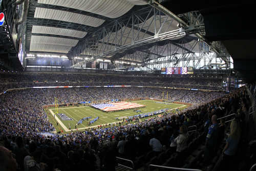 The U.S. flag is unfurled during the national anthem before the first quarter of an NFL football game between the Detroit Lions and the Houston Texans at Ford Field in Detroit, Thursday, Nov. 22, 2012. (AP Photo/Carlos Osorio)