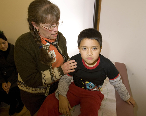 Paul Fraughton  |  The Salt Lake Tribune Dr. Ellie Brownstein examines 6-year-old Ryan Caballero, who has asthma, at the Greenwood Health Center in Midvale Tuesday, November 13, 2012