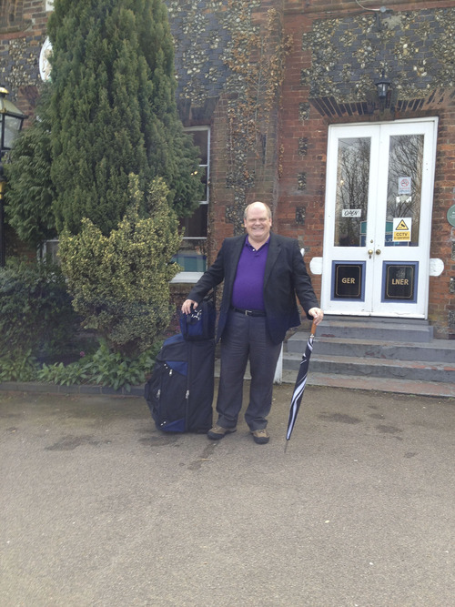 The Rev. Michael Mayor stands in front of the Wymondham Train Station on his way to Cambridge. Courtesy Michael Mayor