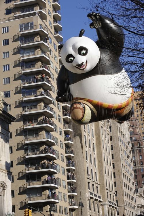 The Kung Fu Panda balloon passes an apartment building on New York's Central Park West at the start of the 86th annual Macy's Thanksgiving Day Parade,Thursday, Nov 22, 2012. (AP Photo/ Louis Lanzano)