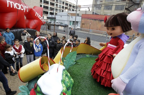 People dressed as the cartoon characters Dora the Explorer and Boots wave to visiting kids at the Macy's Parade Studio in Hoboken, N.J., Tuesday, Nov. 16, 2010.  (AP Photo/Seth Wenig)