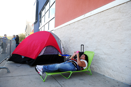 Susan Ellis reclines on her lawn chair as she holds her place as number two in line for Black Friday deals on Wednesday, Nov. 21, 2012 at Best Buy in Abilene, Texas. Ellis said she plans to wait outside the store until the doors open at midnight on Thursday, Nov. 22, 2012. Her husband will take her place in line long enough for Ellis to stop by her mother's home for a bite of Thanksgiving dinner. (AP Photo/Abilene Reporter-News, Joy Lewis)