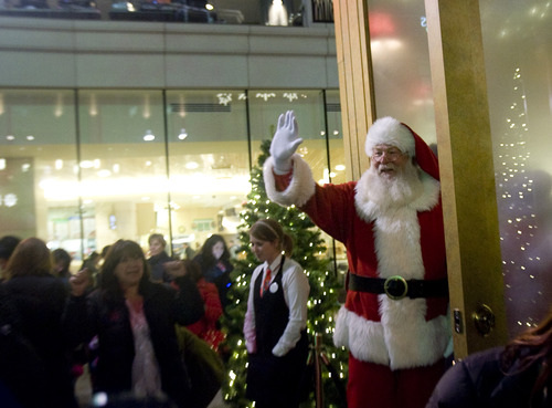 Kim Raff  |  The Salt Lake Tribune Santa waves to the crowd at the Regent Court at the City Creek Center in Salt Lake City on Nov. 15, 2012.  Hundreds gathered in the courtyard of the mall as Santa made his grand entrance. Santa will be at the mall through Dec. 24.