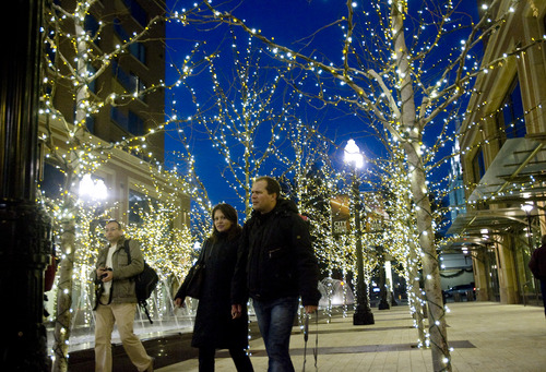 Kim Raff  |  The Salt Lake Tribune (left) Natalia and Sergey Sobolev walk through the Christmas lights display at the City Creek Center in Salt Lake City on Nov. 15, 2012.