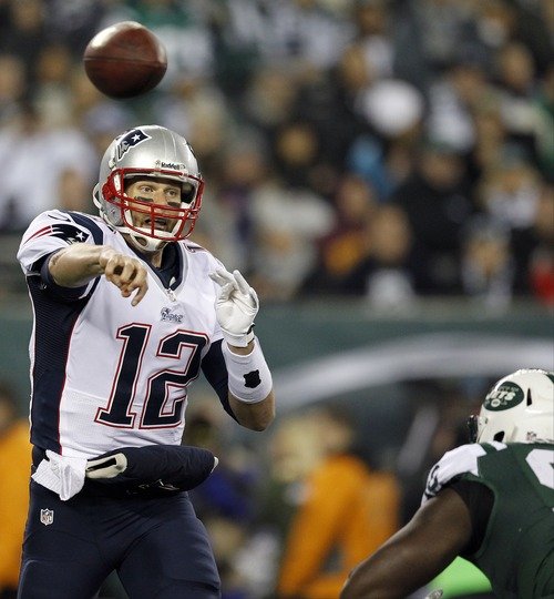 New England Patriots quarterback Tom Brady (12) throws a pass during the first half of an NFL football game against the New York Jets, Thursday, Nov. 22, 2012, in East Rutherford, N.J. (AP Photo/Julio Cortez)