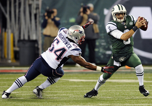 New York Jets quarterback Mark Sanchez (6) is sacked by New England Patriots outside linebacker Dont'a Hightower (54) during the first half of an NFL football game, Thursday, Nov. 22, 2012, in East Rutherford, N.J. (AP Photo/Bill Kostroun)