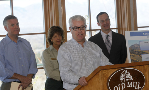 Al Hartmann  |  The Salt Lake Tribune Alta Mayor Tom Pollard speaks at an announcement of the completion of three canyon transportation studies Wednesday, Nov. 21, at Old Mill Golf Course. Behind him, participating in the announcement, are Salt Lake County Mayor Peter Corroon and Cathy Kahlow with the U.S. Forest Service and Andrew Gruber, Wasatch Front Regional Council. The studies provide recommendations concerning transportation projects, environmental processes and analyses of land use, watershed, multiple uses and economic opportunities. The studies began about a year ago and include Mill Creek Canyon and both Cottonwood canyons.