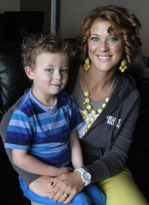Rick Egan  | The Salt Lake Tribune  Brytten Pettit holds her son 4-year-old son, Teagan, in their West Jordan home. Teagan was born seemingly healthy but was diagnosed days later with a heart defect. Brytten supports screening newborns for heart defects.