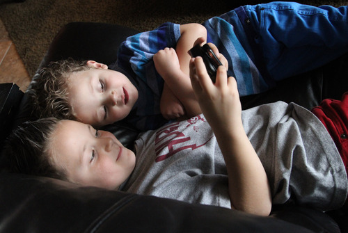 Rick Egan  | The Salt Lake Tribune  Teagan Pettit, 4, plays a video tame with his brother Mason, 7, in their West Jordan home. Utah is studying how to screen newborns for seven heart defects, including the one threatening Teagan's health.