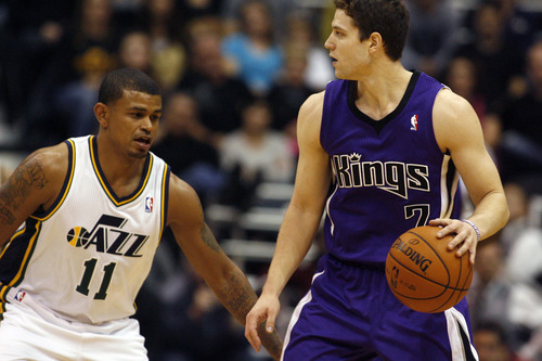 Chris Detrick  |  The Salt Lake Tribune Utah Jazz point guard Earl Watson (11) guards Sacramento Kings point guard Jimmer Fredette (7) during the first half of the game at EnergySolutions Arena Friday November 23, 2012.  The Kings are winning the game 53-52.