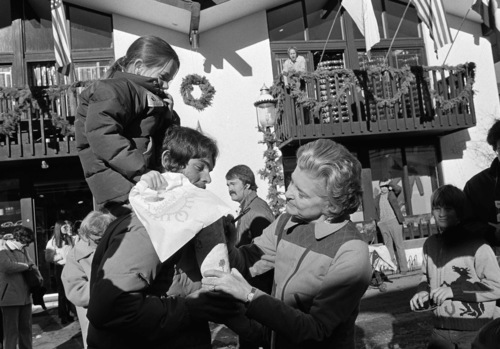 First Lady Betty Ford signs a cast on the leg of Elizabeth Ann Park, 6, who was the first casually of the ski season with a broken leg suffered while on the slopes. Mrs. Ford chatted with Elizabeth and her father Kirk White on a Christmas shopping trip to Vail village on Dec. 21, 1976. (AP Photo)