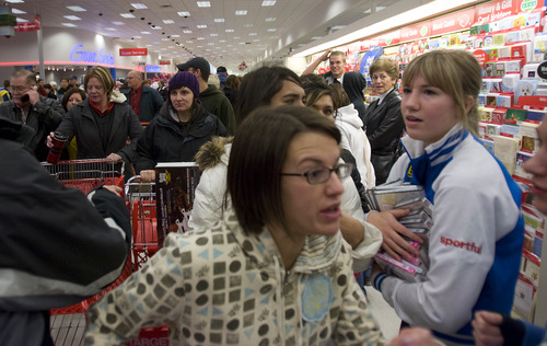 Tribune file photo A huge crowd fills the aisles and negotiates a path heading toward the electronics section to find deals at the Super Target at 7025 South Park Center Drive shortly after it opened at 6 a.m. on Black Friday 2008.