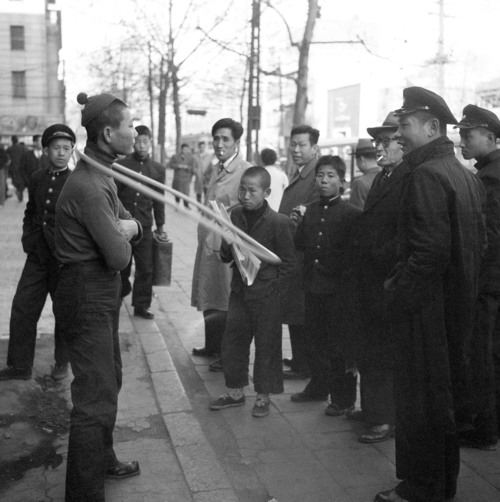 A young man works his hula hoop in downtown Seoul, South Korea, Dec. 11, 1958. A toy shop in hired a few boys to demonstrate the hula hoop in front of the store to attract the attention of shoppers during the holiday season. (AP Photo/Kim Chon Kil)