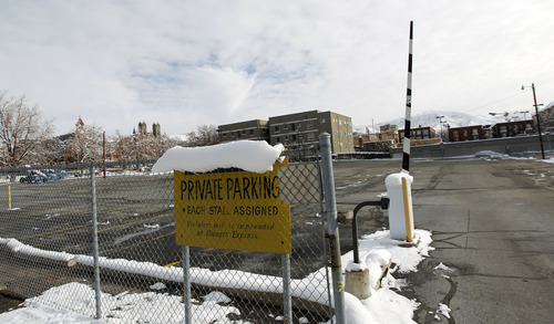 Al Hartmann  |  The Salt Lake Tribune  The parking lot at the northwest corner of 100 South and 200 East is empty Monday Nov. 12, 2012. The Salt Lake City Council is formulating an ordinance that would bar building ownersfrom tearing down their structures for the purpose of creating surface parking lots.